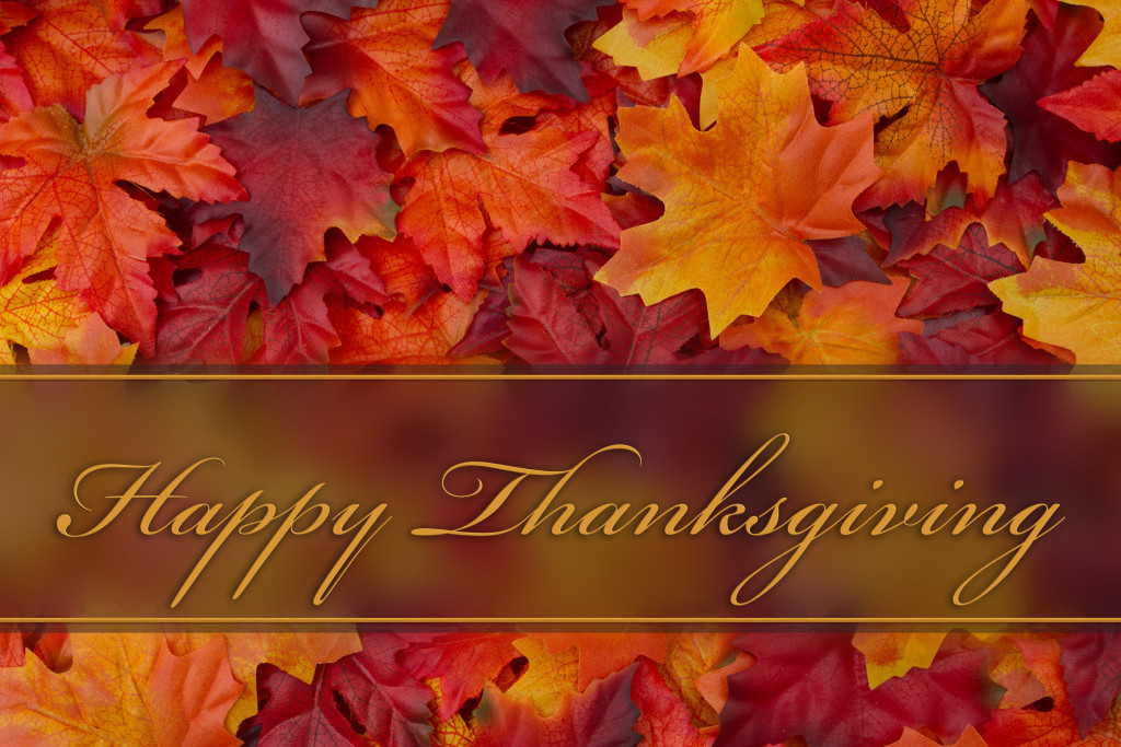 Happy Thanksgiving Greeting, Fall Leaves Background and text Happy Thanksgiving